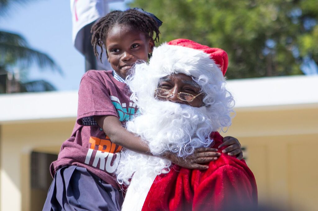 Karen Civil, Lil Wayne, & Andre Berto Spread Holiday Cheer